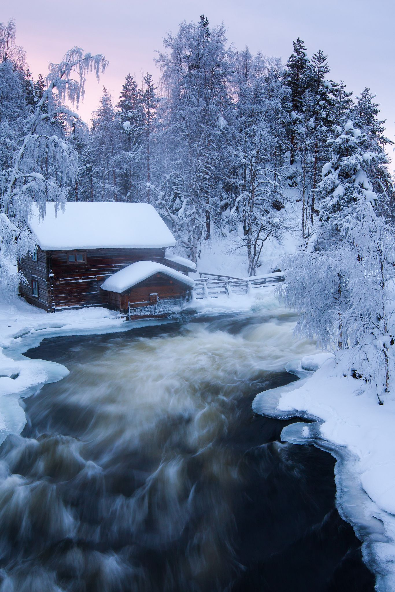 Beautiful Winter Stream Cabins Scene