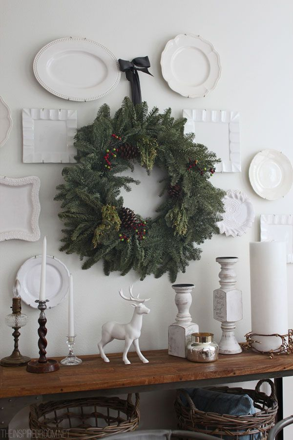 white plates on dining room wall