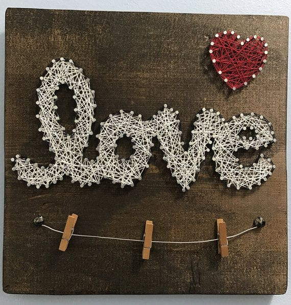 Just in time for Valentines Day!!  Hand stained wood, Love string art board with wire picture holder. Can easily hold 2-4 pictures on the wire with small clothes pins (included). Great gift idea for home decor, holidays, or weddings! Custom colors can be requested. Finished size is 11 square with a picture hanger on the back.  Item ships USPS.