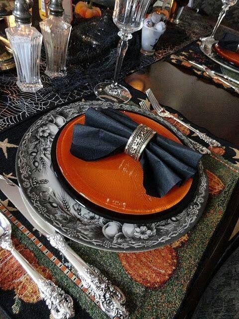 Orange and black plates on black Harvest plate charger Table - halloween table setting ideas