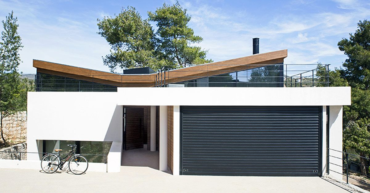 butterfly-roof 'wedge house' by schema is located in a ...