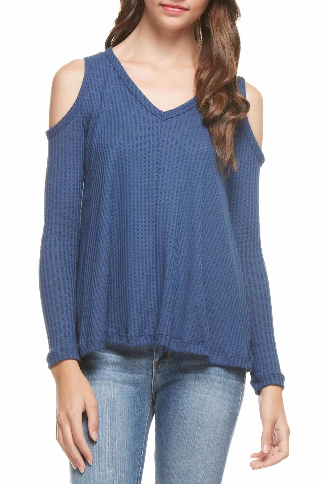 A dark denim blue V-neck textured top with a cold shoulder. The A-line cut gives this top a flattering fit. Wear with a floppy hat and some platforms for a 70's inspired look!   Cold Shoulder Top by Final Touch. Clothing - Tops - Casual Clothing - Tops - Long Sleeve Pennsylvania