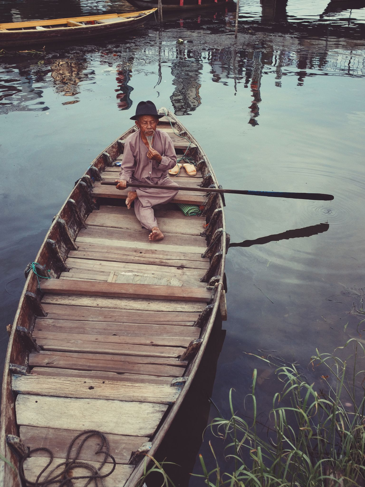 Old Man -  An old man will take you on the boat ride on the river in Hoi An…