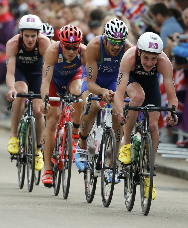 Britain's Alistair Brownlee (R) competes in the men's triathlon final during the London 2012 Olympic Games at Hyde Park August 7, 2012.