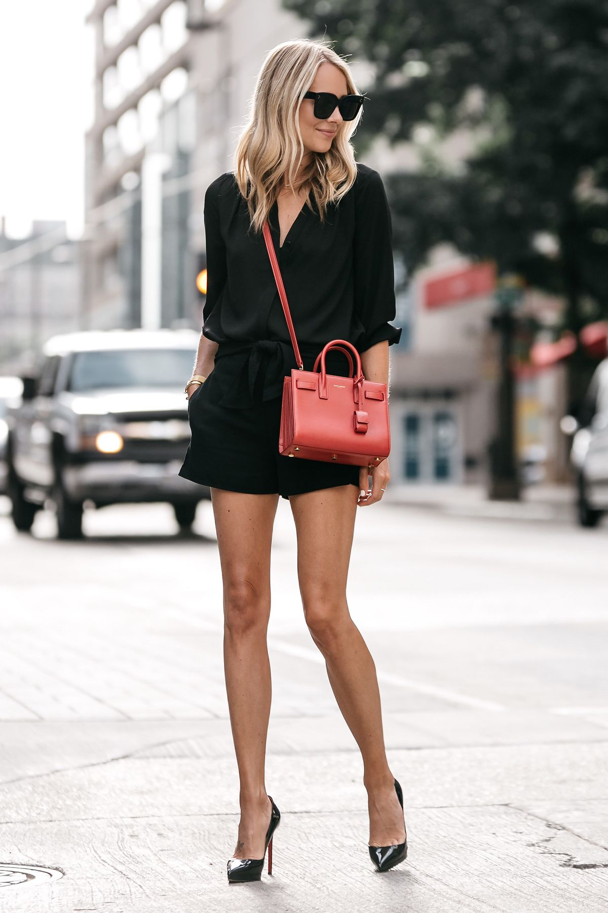 d0febd0b812 Blonde Woman Wearing Nordstrom Black Blouse Nordstrom Black Tie Front Shorts  YSL Sac De Jour Nano Red Christian Louboutin Black Pumps Street Style Outfit  ...
