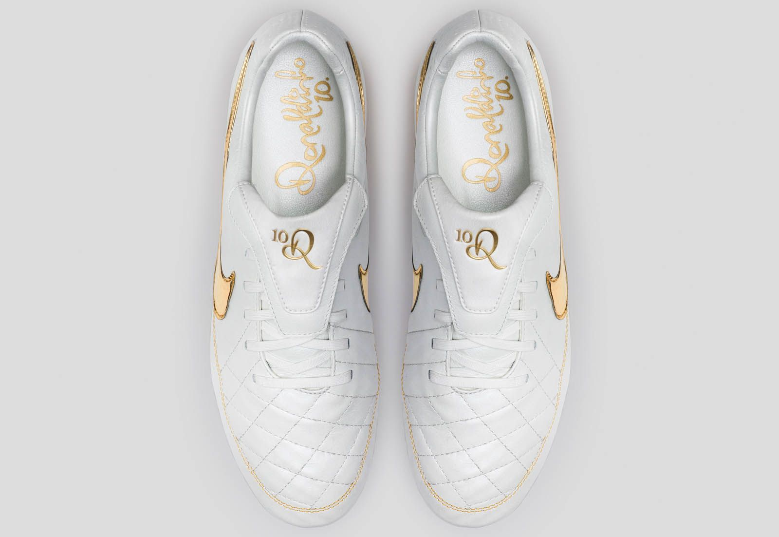 c9cdc459dcd5 The Nike Tiempo Legend Ronaldinho Boots celebrate Ronaldinho's magnificent  career in unrivaled fashion. A white base is combined with classy gold  accents to ...