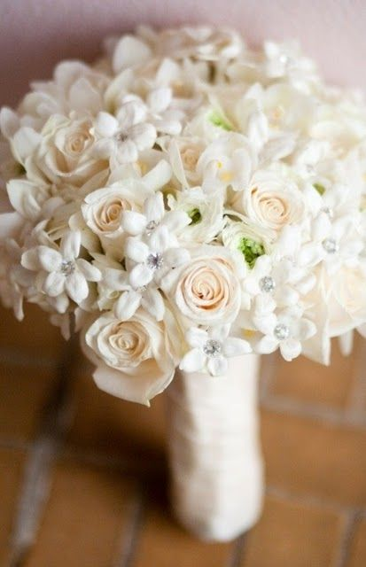 White Wedding Bouquet A Of Creamy Roses And Ranunculus Orchids Stephanotis Had Clic Look For Some Glam Each Crystal Pin
