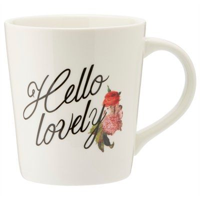 "We love a mug that loves you back. Our new ""Hello Lovely"" mug has a gently tapered shape feels good in your hands, just like a warm hug, and is generously sized to satisfy. 16-oz. (473ml) capacity. 4"" diameter, 4.5"" tall. Porcelain. Dishwasher- and microwave-safe. Available only at Indigo."