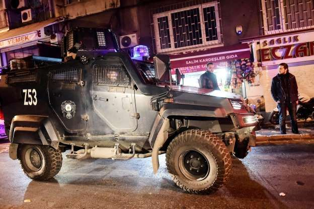 Turkish special force police officers patrol streets after a car bomb exploded near the stadium of football club Besiktas in Istanbul on December 10, 2016. The car bomb exploded in the heart of Istanbul on late December 10, wounding around 20 police officers, Turkey's interior minister said, quoted by the official Anadolu news agency. The bomb, apparently targeting a bus carrying police officers, exploded outside the stadium of Istanbul football club Besiktas following its match against…