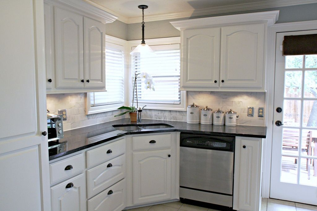 carrera marble backsplash black granite countertops ... on Black Granite Countertops With Backsplash  id=66719