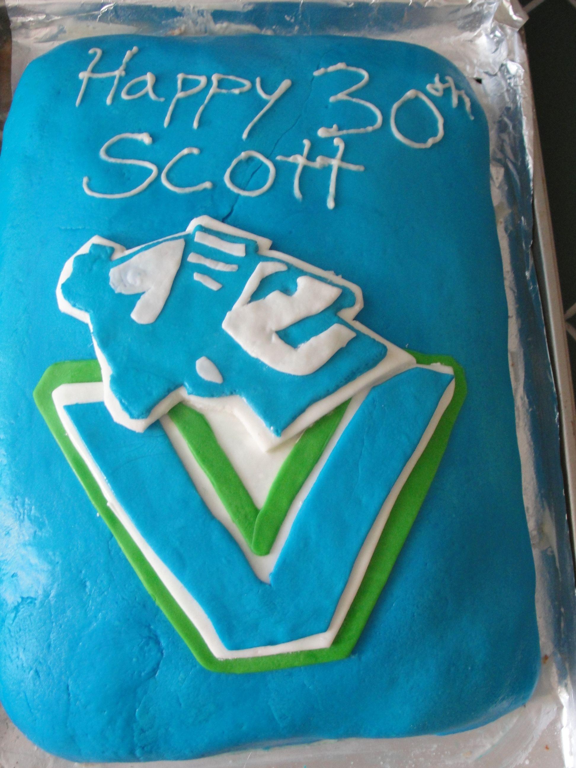 Canucks cake for my husbands 30th cake sugar cookie