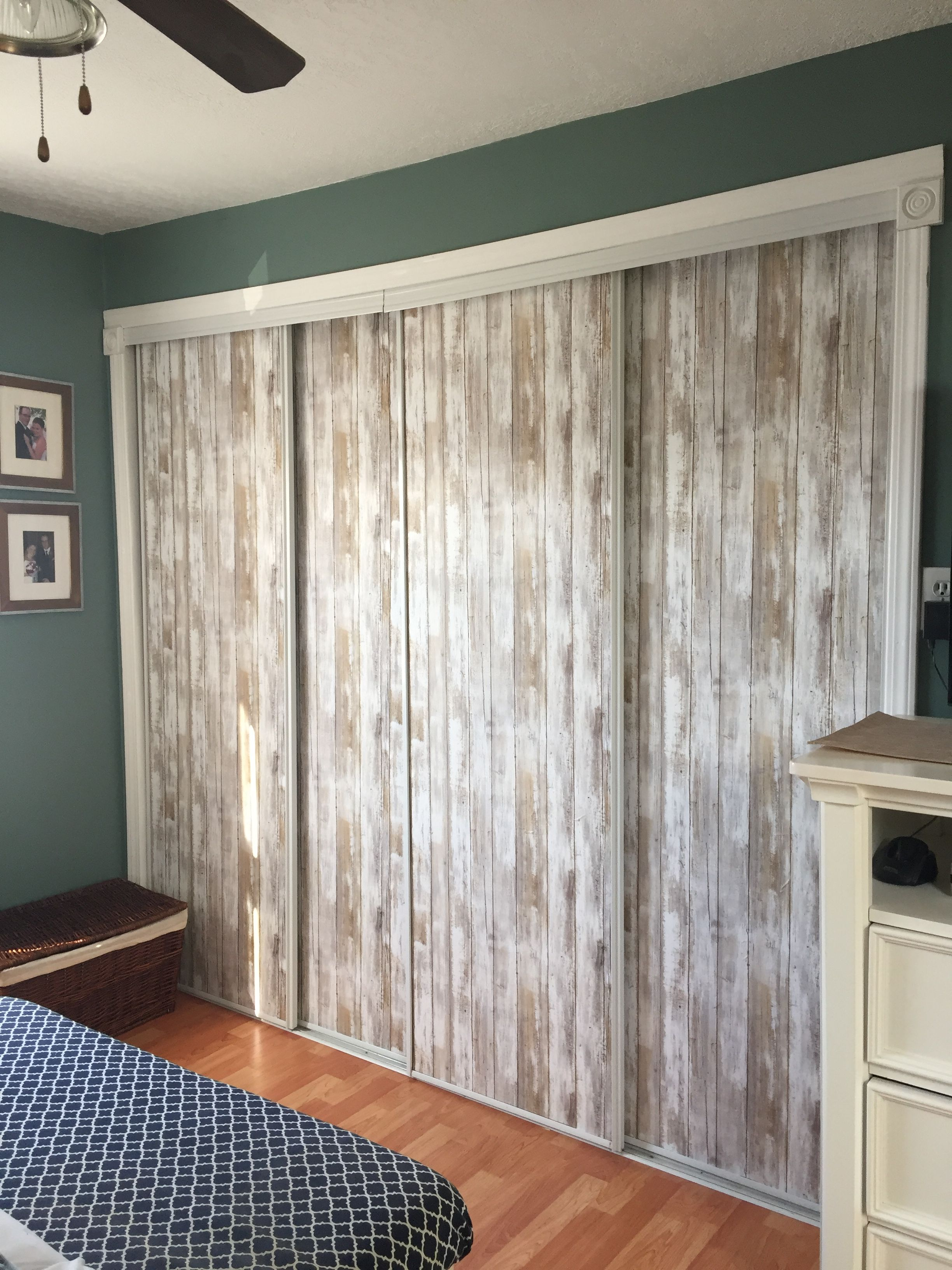 Peel And Stick Barnboard Wallpaper To Give Mirrored Closet Doors A Major Upgrade With Minimal Cost Mirror Closet Doors Closet Doors Mirrored Cabinet Doors