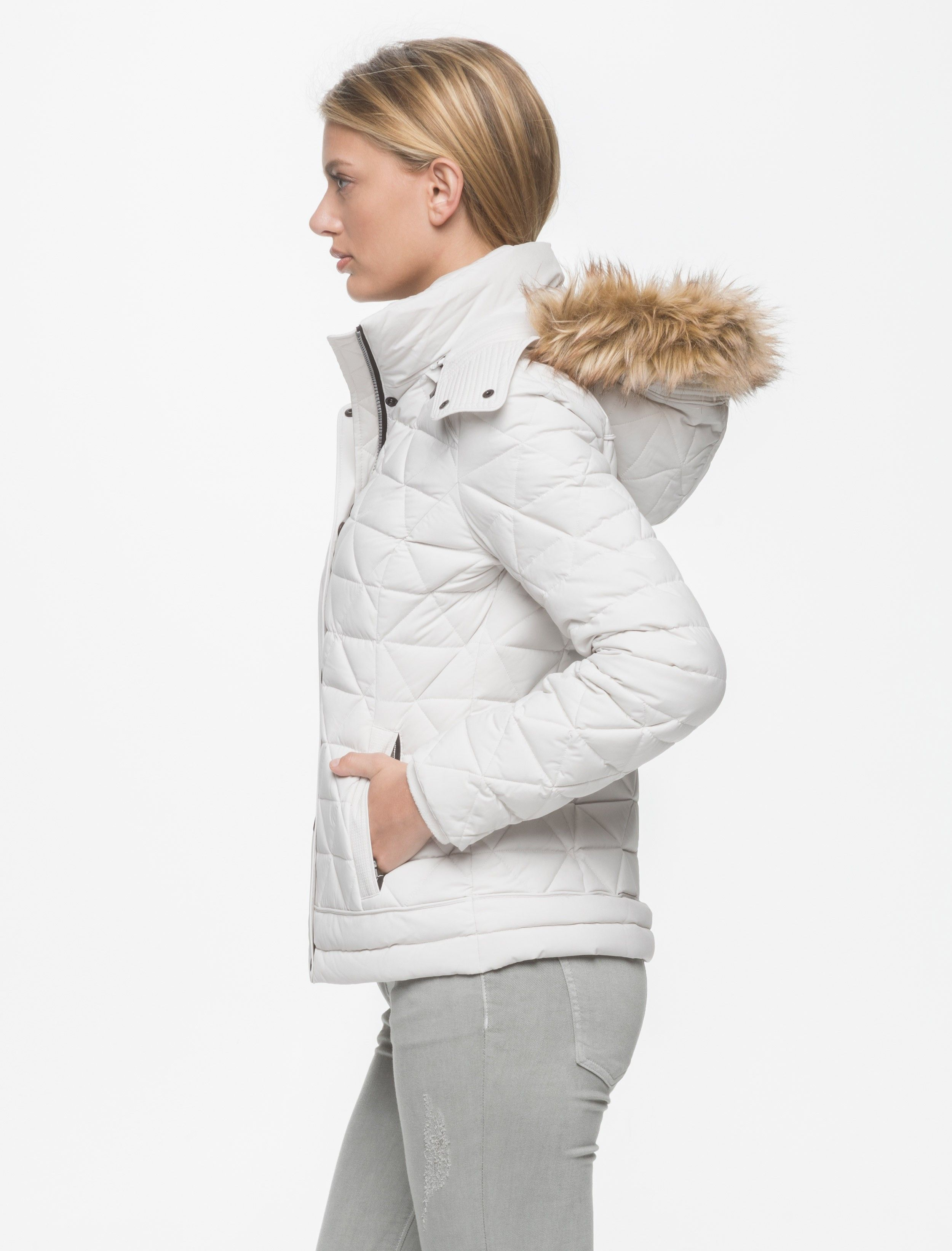 The Tess puffer coat is made from a durable, coated water-repellent fabric that stretches for a c...