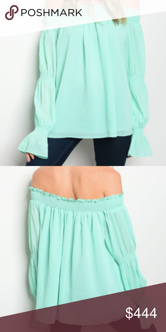 12a5c6a222813  JUST IN  Mint Off-shoulder Top This flirty top is an off the shoulder  blouse that features ruffled cuffs. Model is wearing actual item in size  small.