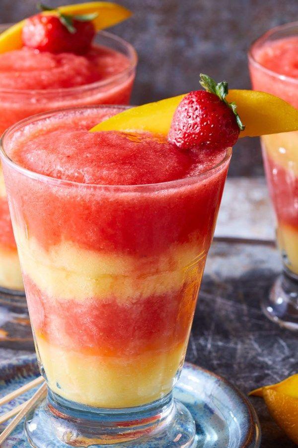 Swirl Layers Of Red Strawberry Margarita With Yellow Mango Margarita In This Skinny Frozen Cocktail Fo Mango Margarita Margarita Recipe Frozen Frozen Cocktails