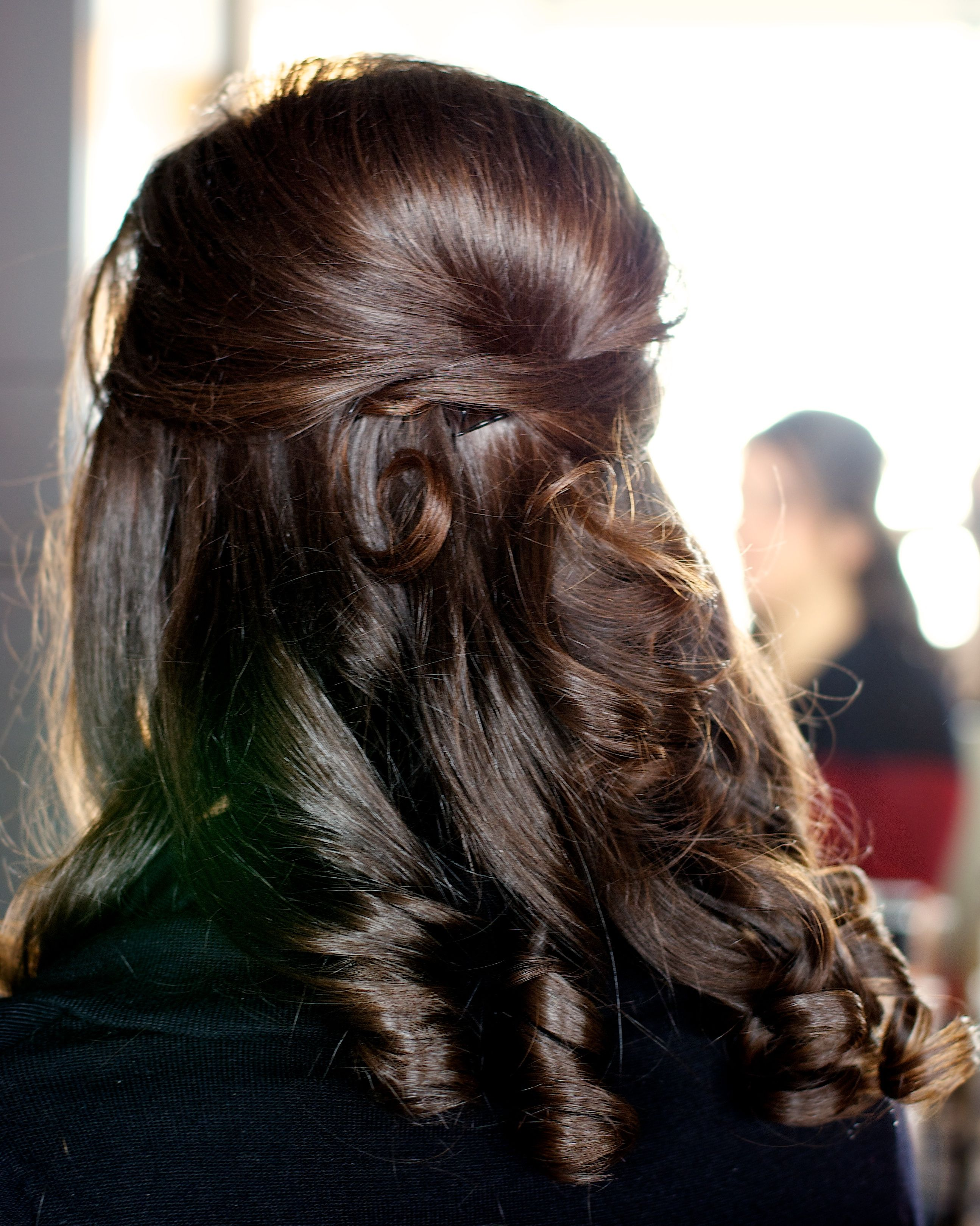 Half up formal hairstyle for a wedding prom homecoming or other