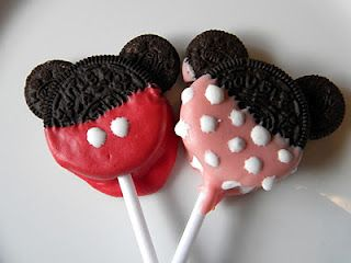 """Mickey and Minnie Mouse Oreo cookie pops. Press some mini Oreos halves into the Double Stuffs, and then dip the bottoms into colored Winston's candy melts. Decorate with white icing that hardens to add dots, and then stick a candy stick in for a fun """"lollipop"""" twist."""