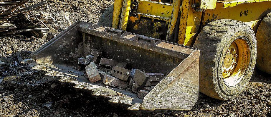 GEHL Skid Steer Moves Demolition Debris At A Demo Project In