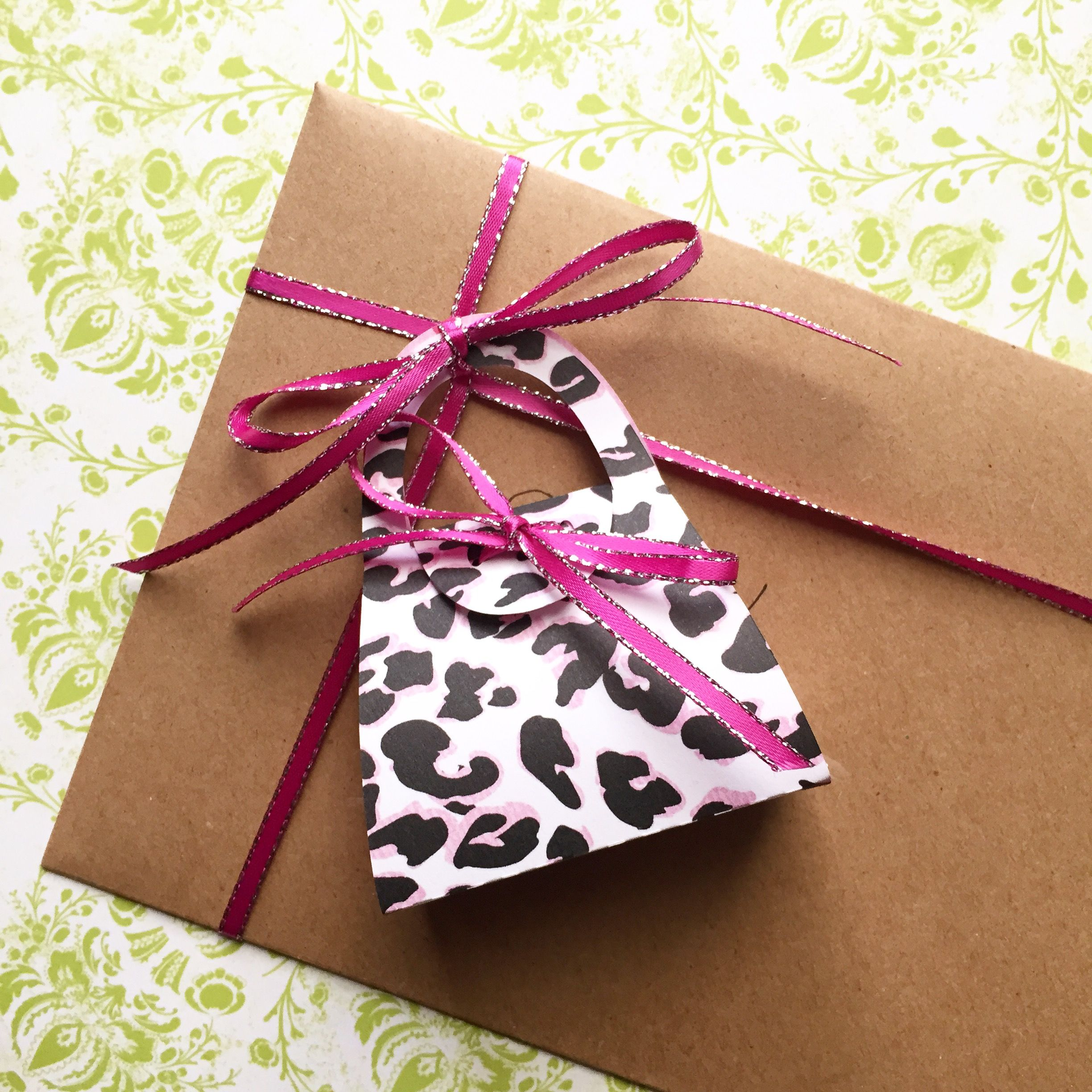 Gift wrapping idea. Mini purse gift tag or little party favor. It is just the right size for a single chocolate! Leopard print with pink.