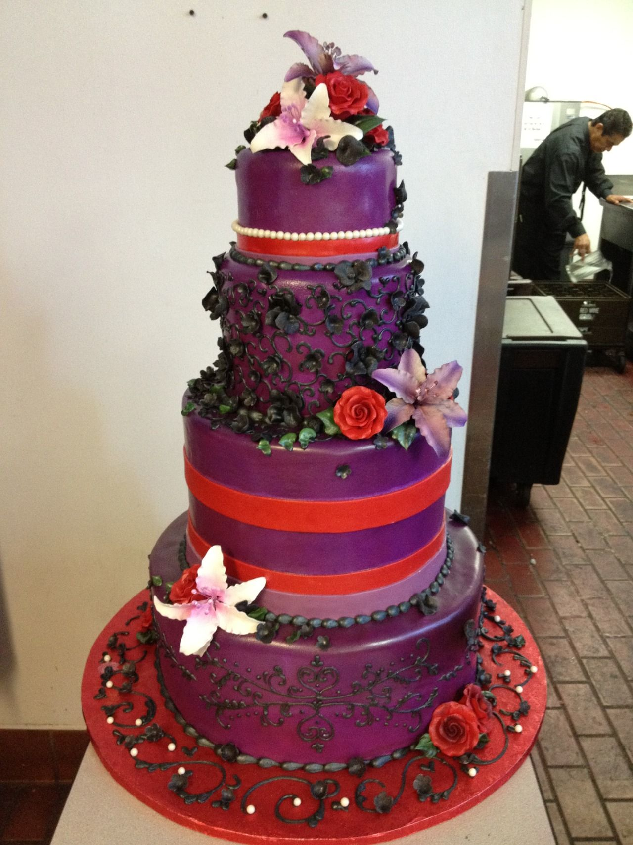 Purple Red Wedding Cake With Lilies