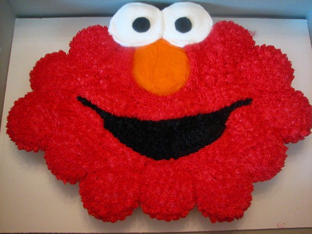 Elmo Cupcake Birthday Cake - I made this cupcake cake for a two year old's birthday party. I used 20 cupcakes and all buttercream frosting.