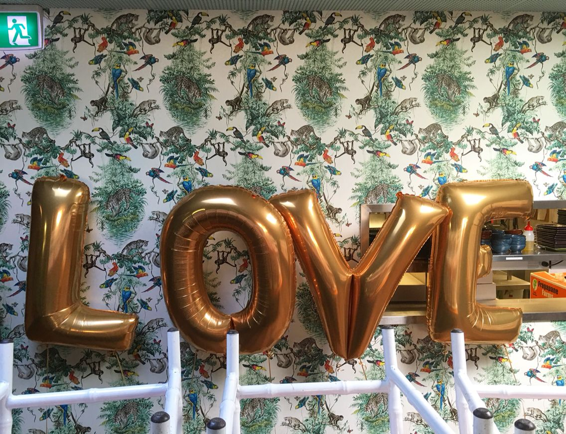 gold letter balloons spelling love for an engagement party
