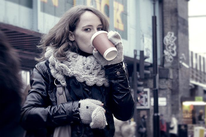 Woman drinking coffee in London.