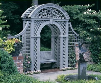 Arbor - Defining a formal brick-enclosed rose garden, this custom arbor illustrates how beautifully a combination of architectural elements work together in the garden.