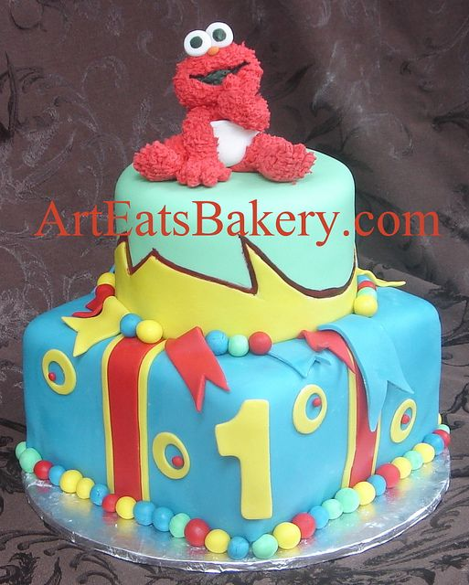 Two Tier Blue Yellow Green And Red Creative Unique 1st Birthday Cake With Edible Elmo Topper By Arteatsbakery Via Flickr