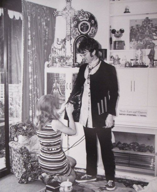 John Lennon in a costume fitting.