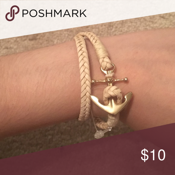 Anchor bracelet Tan braided bracelet with gold anchor. Brand new never worn once Jewelry Bracelets