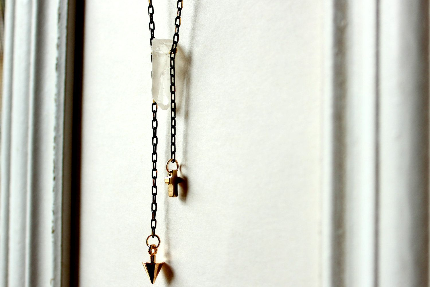 raw rock crystal point necklace-raw crystal necklace-tassel necklace-tiny cross necklace-gold spike necklace. $13.00, via Etsy.