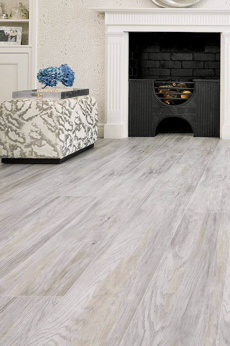 Cool Grey Vantage 10mm Laminate Flooring Glacier Oak Brings A Fresh Modern Vibe In 2020 Laminate Living Room Living Room Tiles Living Room Wood Floor