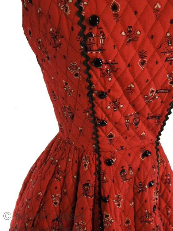 Traditional black-and-white alpine print on true red. Quilted cotton fabric with black rick-rack trim. Sleeveless bodice opens along one of the front princess seams. Bust darts. Double row of black bu: