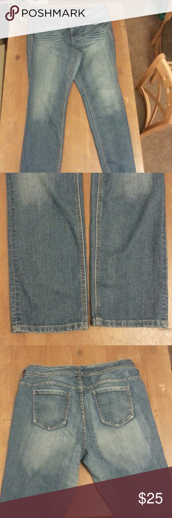 Torrid jeans Medium wash jean with silver hardwear.  Beautiful condition. Comfy and has a little stretch! Torrid Pants Straight Leg