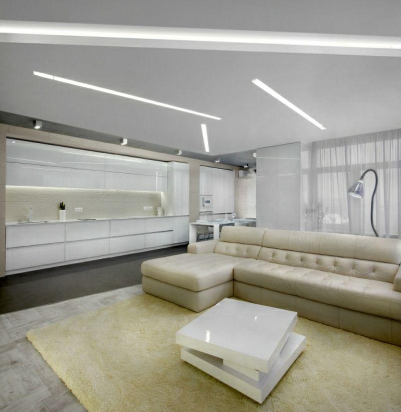 Modernes Wohnzimmer Mit Offener Küche Weiss Und Creme Deckenbeleuchtung