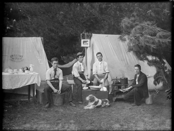 Group of unidentified young men preparing food outside tents J Welsh Maker Christchurch & Group of unidentified young men preparing food outside tents J ...
