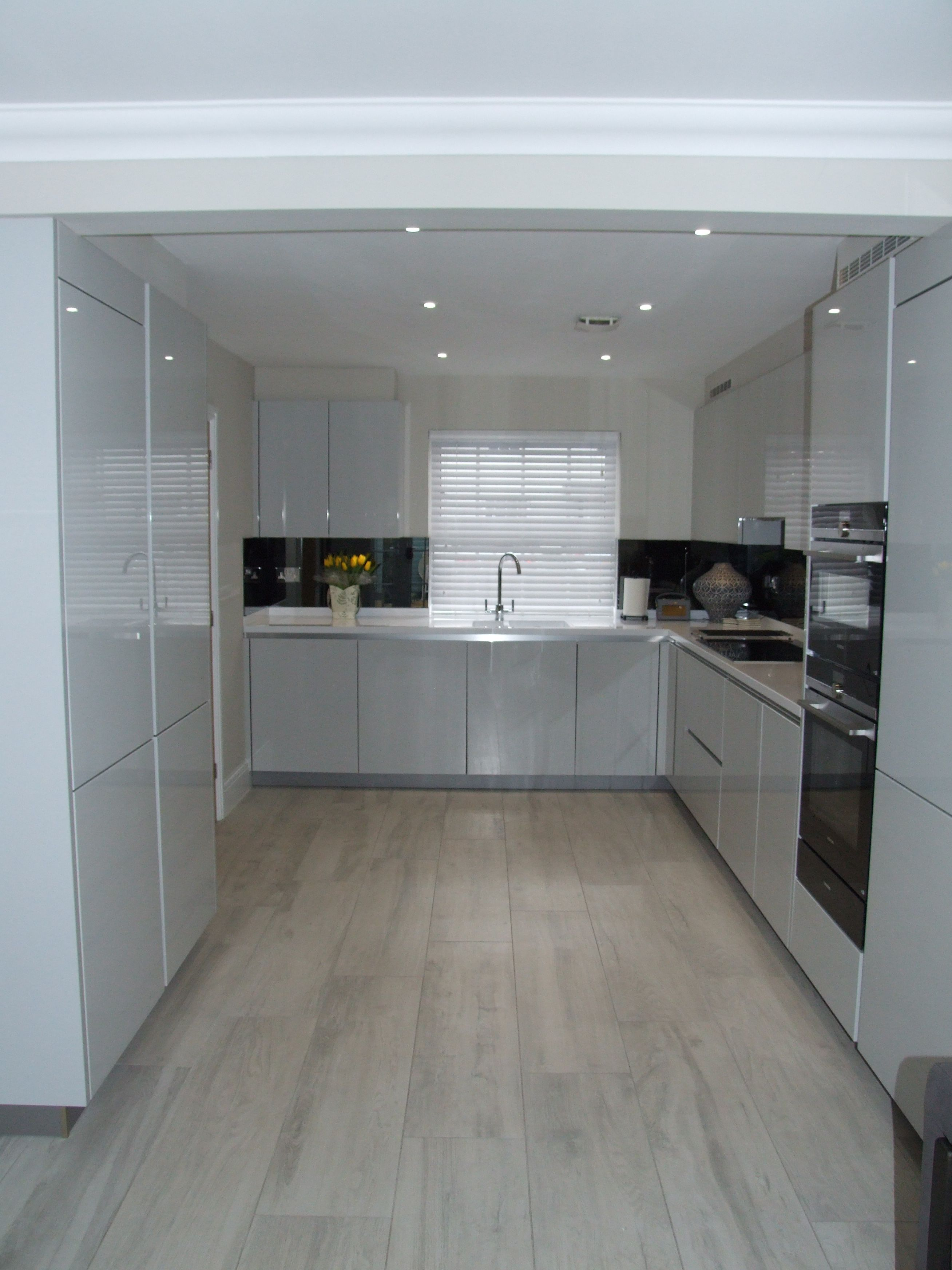A Beautifully Bright And Modern Handleless Kitchen In High Gloss Light Grey With Designer White Modern Grey Kitchen White Kitchen Interior Grey Kitchen Designs
