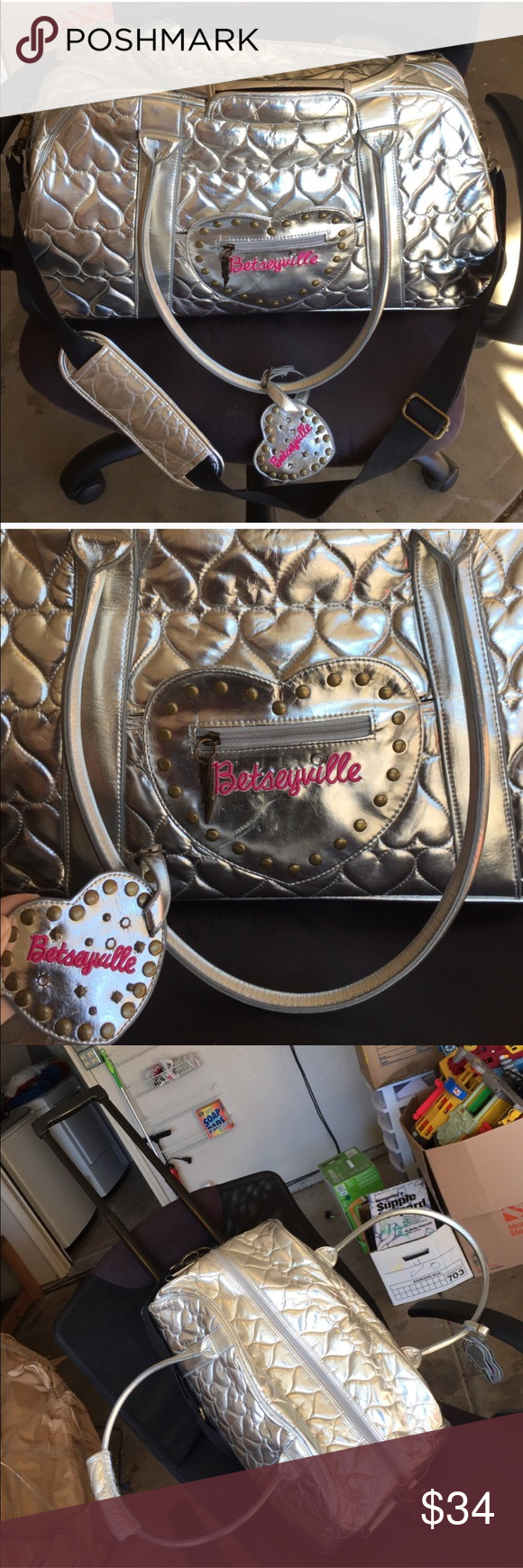 Betsey Johnson silver quilted rolling suitcase Used but still has a lot of life left! Back has some scratches as shown in last pic but top, front/sides, inside are all in pristine condition! Has wheels and retractable handle. Betseyville silver quilted heart print with matching luggage tag. Perfect size for airport carryon! Paid over $200 for this. PRICE IS FIRM DUE TO WEIGHT OF ITEM I WILL BE PAYING ADDITIONAL SHIPPING SINCE POSH ONLY COVERS 5lbs AND UNDER! Betsey Johnson Bags Travel Bags