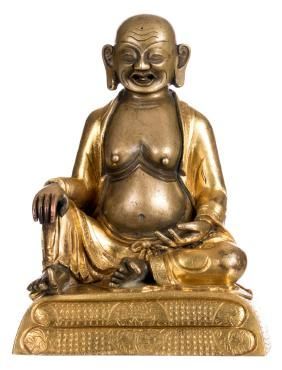 A Sino-Tibetan bronze and gilt bronze seated lama,