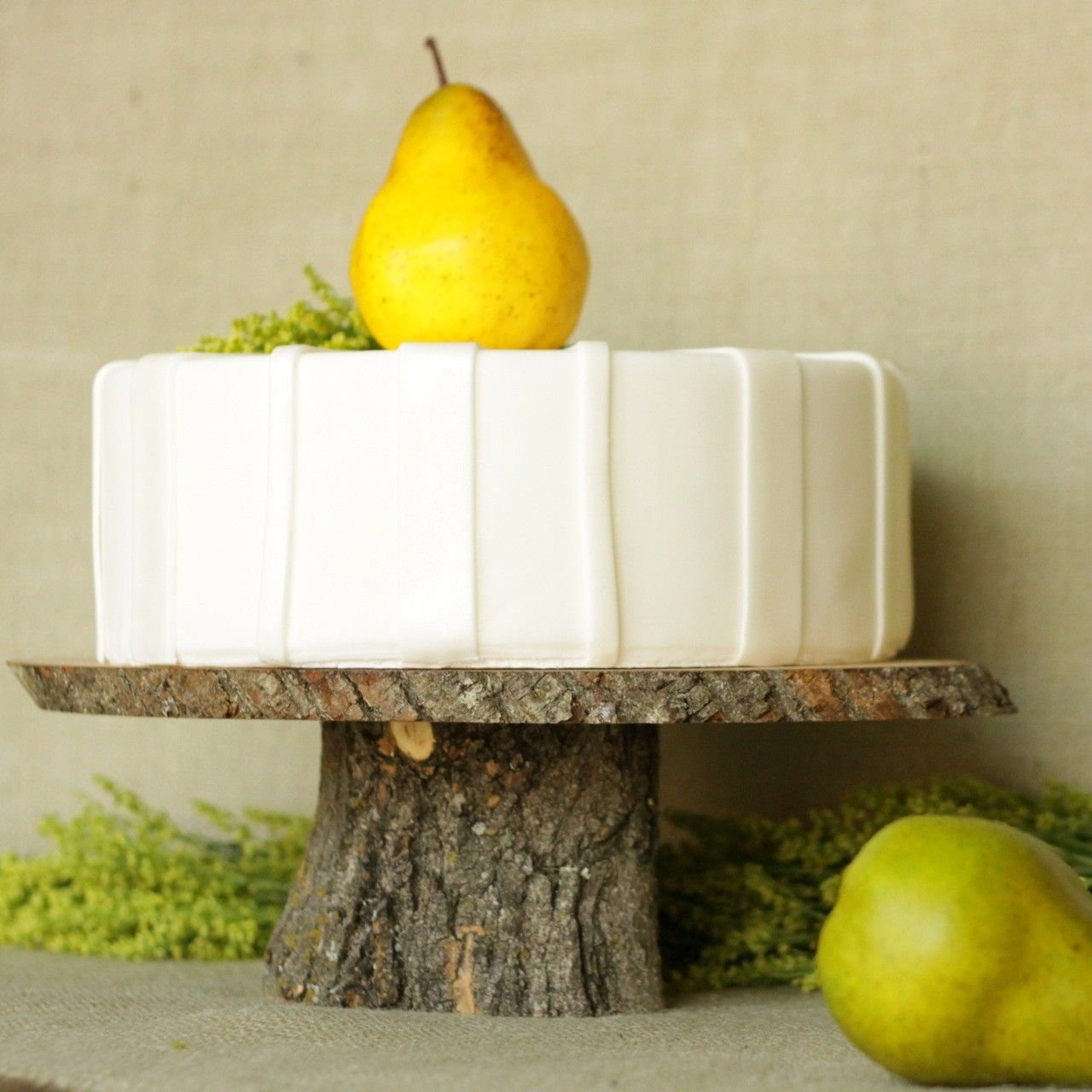 Large wooden cake stand for rustic wedding featured in food network