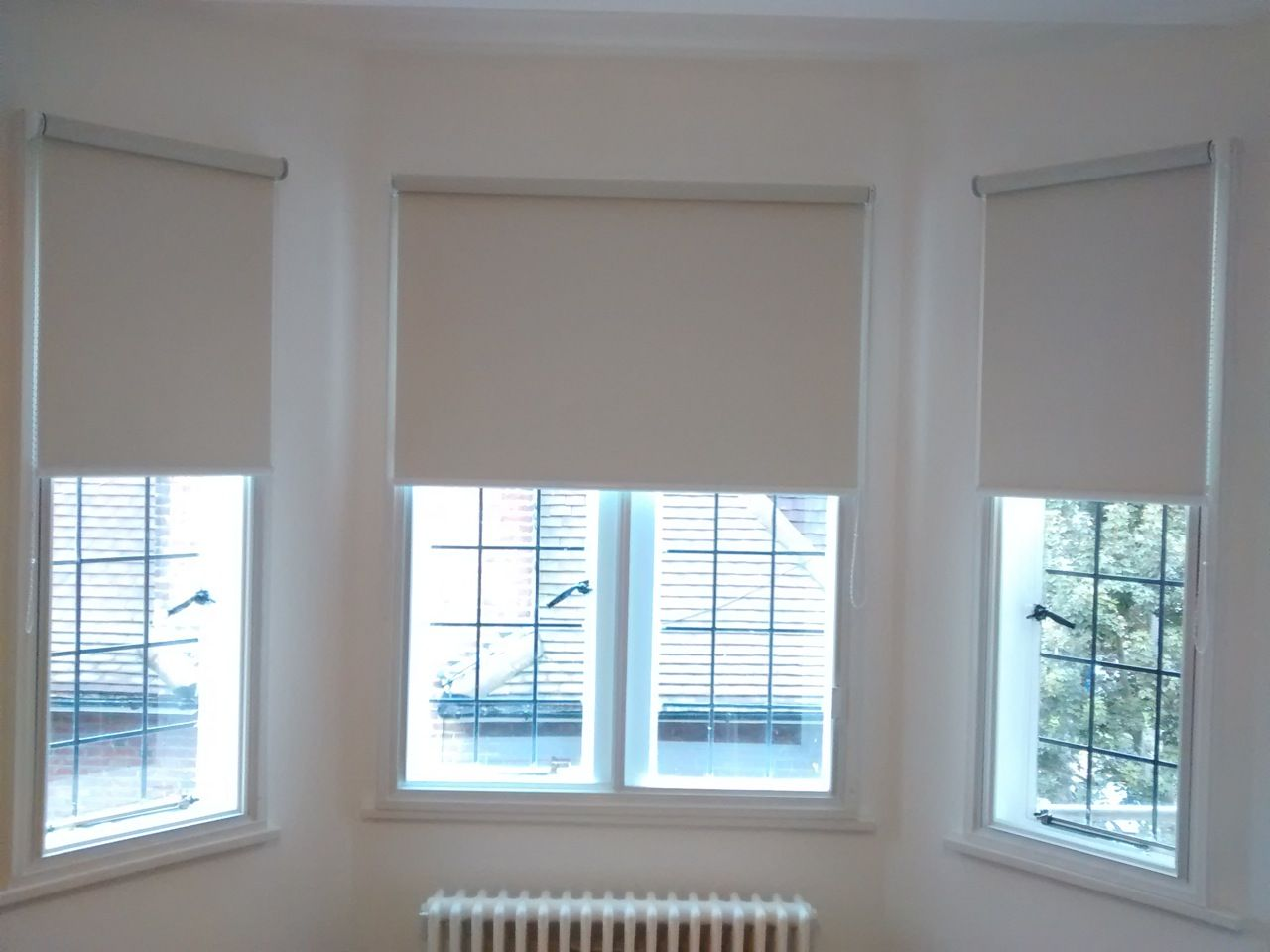 Blackout roller blinds fitted to a bay window first home for Shades for bedroom windows
