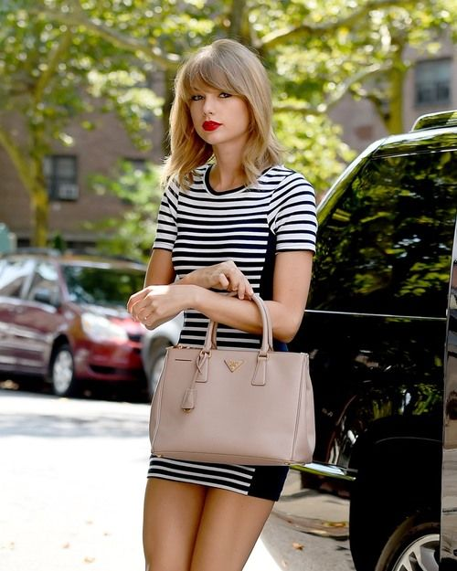 c57004e14f19 Taylor Swift summer street style with striped dress and Prada tote bag. # taylorswift