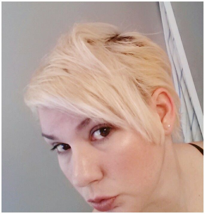 Bleached blonde short hairstyle.  Love the split.