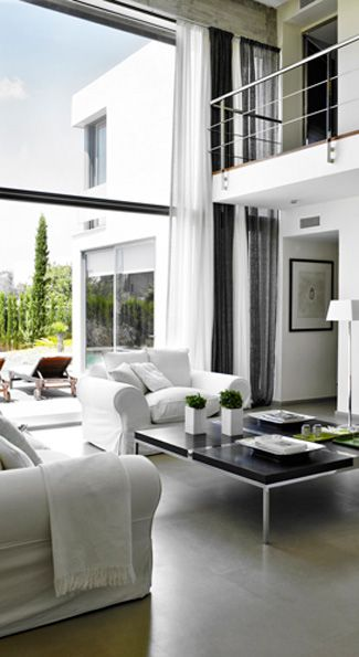 Polished concrete floor high ceiling glass wall and the great