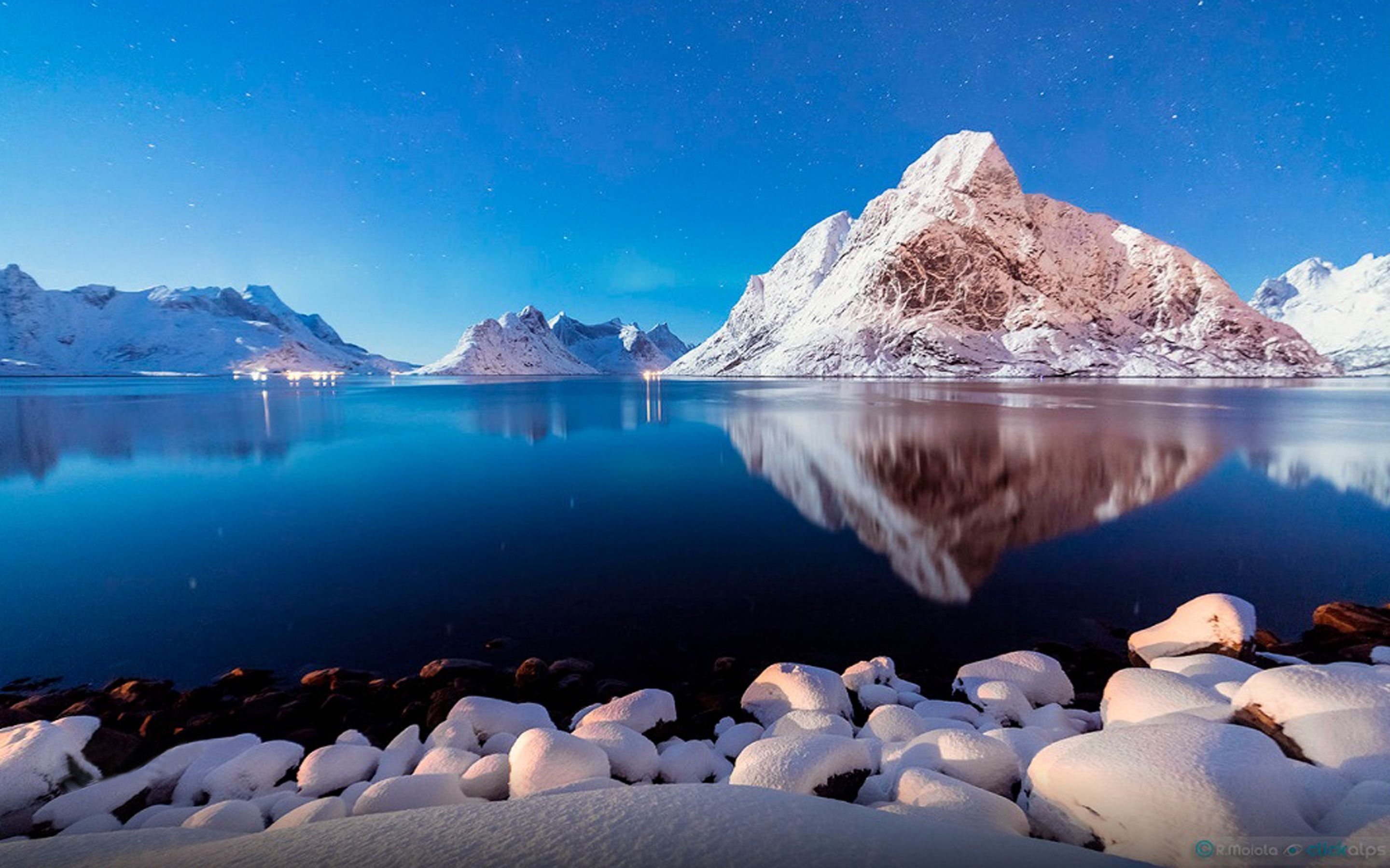 Winter Peaceful Lake Shore Stones Snow Mountains Blue Reflection In Water 2880x1800 Music Indieartis Water Reflections Cool Landscapes Wonders Of The World