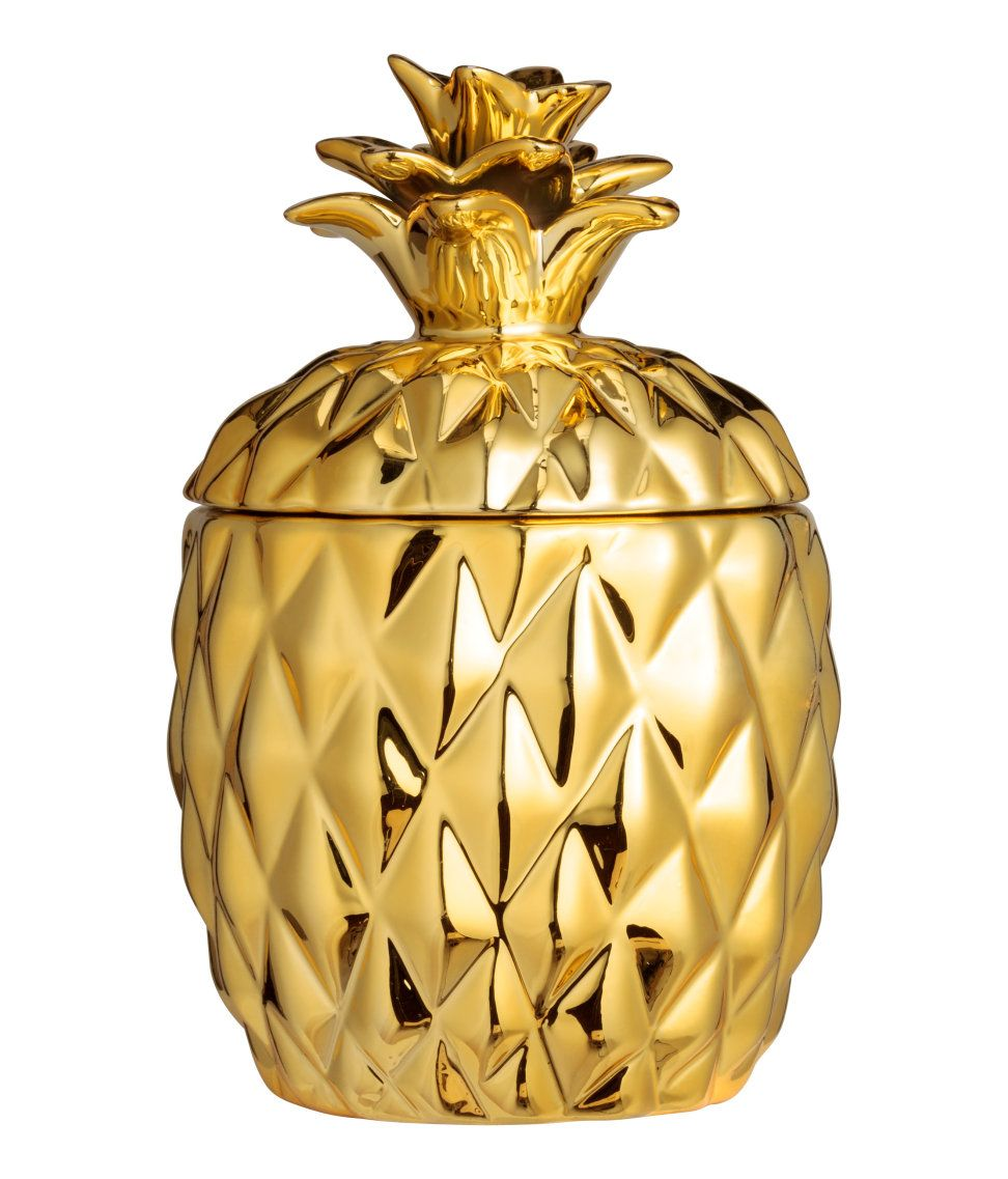 Check this out candle in a pineappleshaped ceramic holder with lid