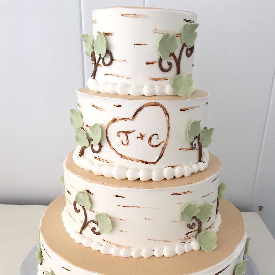 Each tier of this birch tree wedding cake has been decorated to look ...