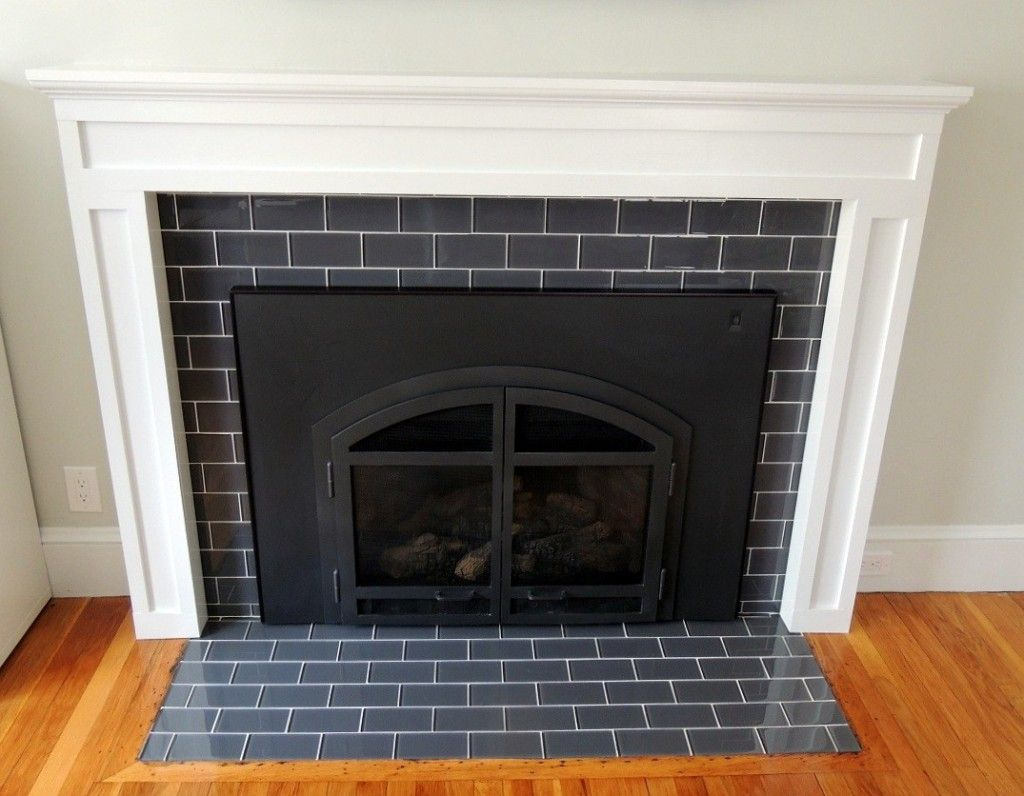 subway tile fireplace surround with