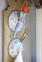 Neat idea.....Use of old enamel lids mounted on a old cutting board.